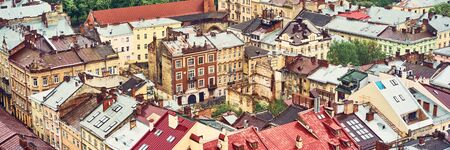 Lviv, Ukraine - May 20, 2019: View of the old Lviv. Bright color roofs of houses in historical city center. Banner crop 3 in 1.