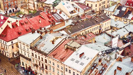 Lviv, Ukraine - May 20, 2019: View of the old Lviv. Bright color roofs of houses in historical city center. Banner crop 16 in 9. Editorial