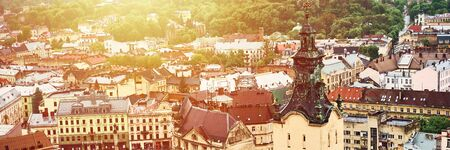 Lviv, Ukraine - May 20, 2019: View of the old Lviv. Bright color roofs of houses in historical city center. Banner crop 3 in 1. Stock Photo - 133579138