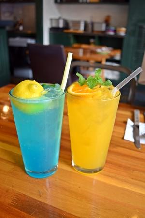aide: Blue lemonade and orange aide Stock Photo