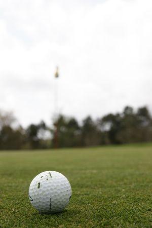 golf ball go on hole photo