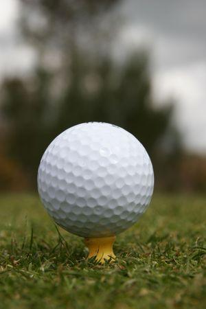 golf ball on the tee photo