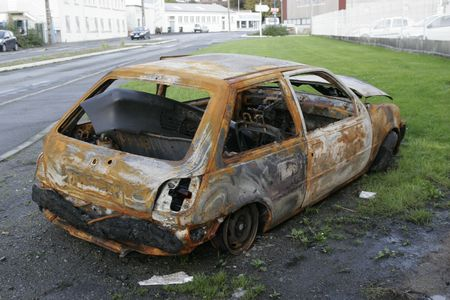 wreckage: a all burned abandoned car Stock Photo