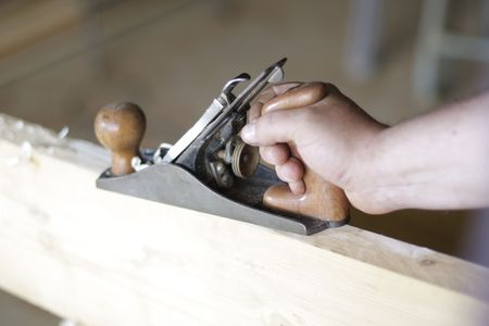 planer: manual planer on a wood plank