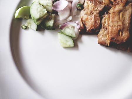 Pork satay on the wooden table