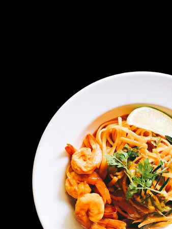 Spaghetti Tom Yum kung on black isolated