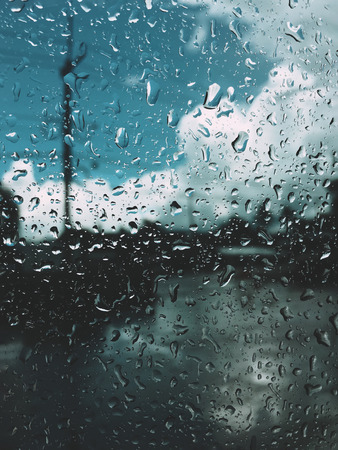 Morning raining day and droplet at the mirror. Blur a  background. Stock Photo