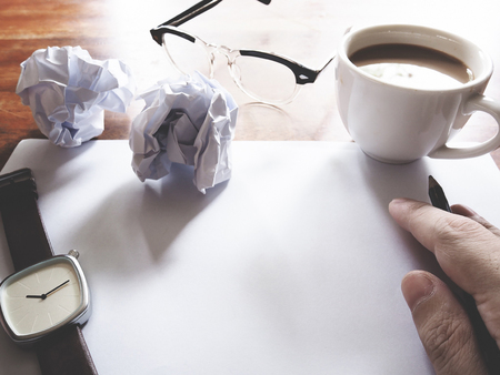 failed plan: Businesses have both been successful and fail. The picture of fail work, glasses, paper, pencil, watch, a cup of coffee  and men hand gesture above wooden table.  soft tone color