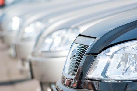 A shiny row of cars. photo