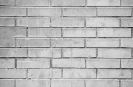 The monochrome brick wall of a house  photo