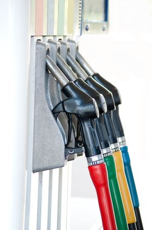 gasoline station: A row of petrol pump nozzles at a garage.  Stock Photo