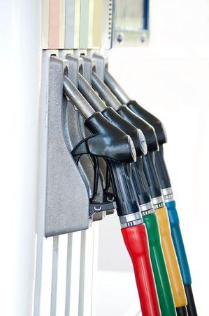 gasoline: A row of petrol pump nozzles at a garage.  Stock Photo