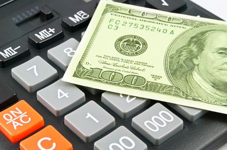 financial item: close-up dollars over calculator Stock Photo