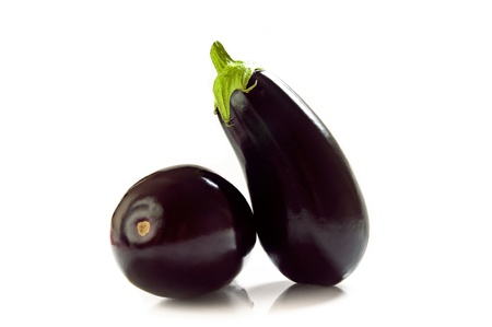 Black eggplants photographed on white background.  photo