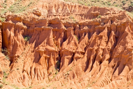Scenic red rocks and screes of sandstone in the mountains of Kyrgyzstan Stock Photo - 17419864
