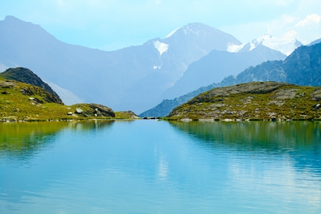 Mountain  Range with  its  Reflection in the Glacial Lake, altai, siberia, Russia  Stock Photo