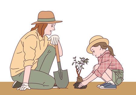 A mother and daughter are planting a tree together. 스톡 콘텐츠 - 165796158