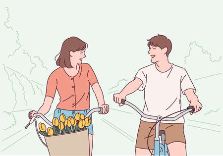 A couple is having fun riding a bicycle.