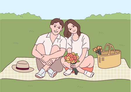 A couple is sitting romantically on a mat. 스톡 콘텐츠 - 165796215