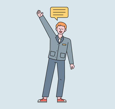 A male student in a school uniform raises his hand and speaks. A speech bubble floats above the boy's head. flat design style minimal vector illustration.