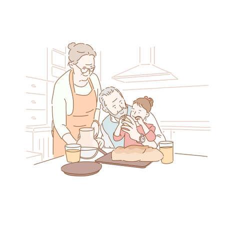 An elderly couple is feeding their granddaughter food.