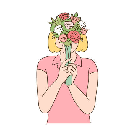 A woman is holding a flower in her hand and covering her face.