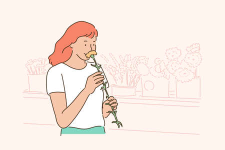 A woman is smelling a flower. hand drawn style vector design illustrations.