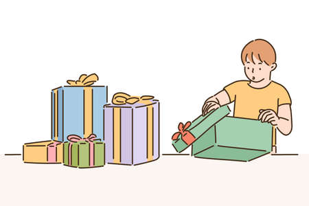 A cute boy is opening a gift box. hand drawn style vector design illustrations. 일러스트