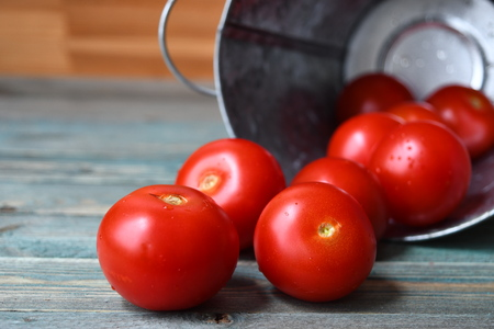 tomato on the wood background