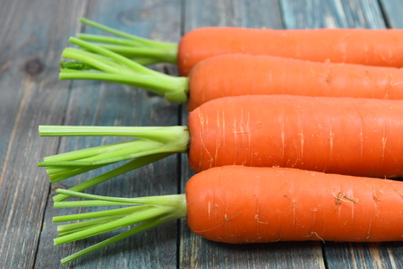 carrots on the wood background