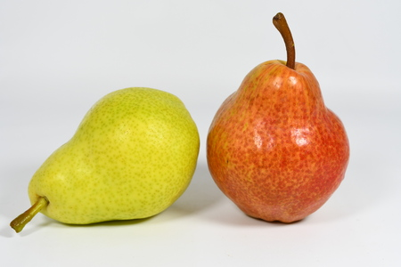Pears on the white background Imagens