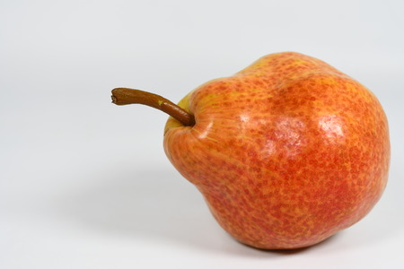 Red pear on the white background