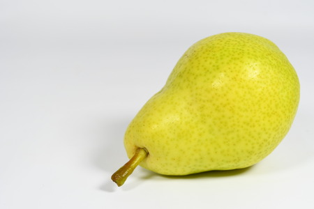 Yellow pear on the white background