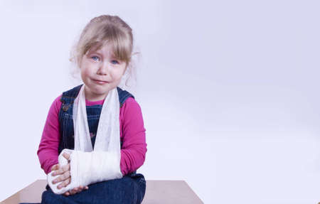cries: the child with the broken arm in a gypsum cries