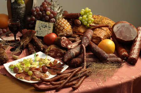 still life from meat of sausage of fruit and cheese