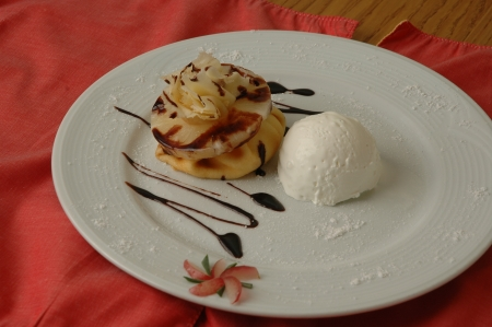 watered: ice cream and pineapple dessert watered with chocolate