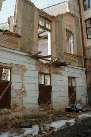 remained: remained after destruction the house costs and collapses Stock Photo