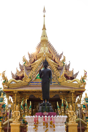 ordain: Big black Bhudda infront of golden temple in Ubon Thailand Stock Photo