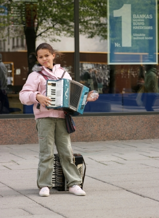 A girl with accordion in pedestrian street during Street music day in Kaunas (Lithuania), May 19, 2011. This event is dedicated to young Lithuanian musicians and bands basically who have an opportunity to play live in various parts of the city.