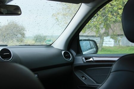 Hiding inside the car during pouring rain photo