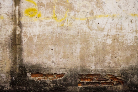 crack pipe: old street brick wall background