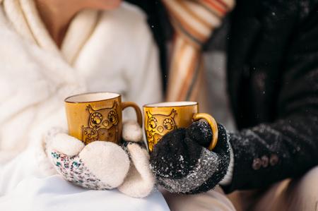 couple winter: couple in love drinking tea in winter