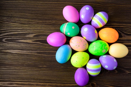 easter background: Easter eggs on wooden background, colorful, bright Stock Photo