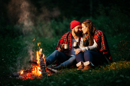 campfire: Nature lovers on sitting around the campfire at night Stock Photo