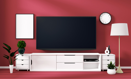 Smart Tv Mockup with blank black screen on cabinet and decoration in cora color room.3D rendering Banco de Imagens