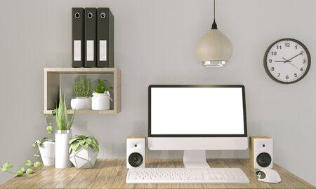 computadora con pantalla en blanco y decoración en la habitación de la oficina simulacro de fondo representación 3D