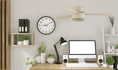Simulacros de computadora con pantalla en blanco y decoración en la sala de oficina simulacros de fondo. Representación 3D Foto de archivo