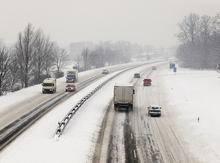 Snow calamity on highway with lot of cars Stock Photo