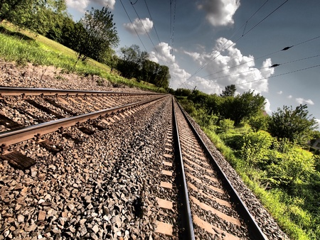 Double railroad track with HDR effect leading into the distance Stock Photo - 9810910