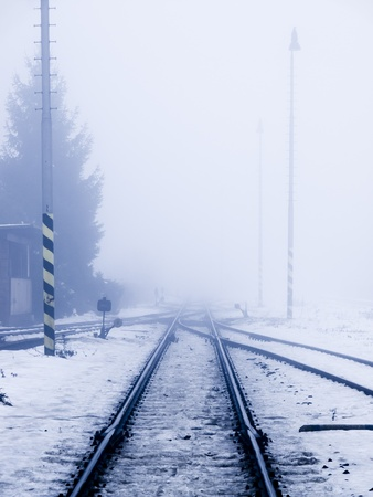 Perspective view of railroad in winter smog